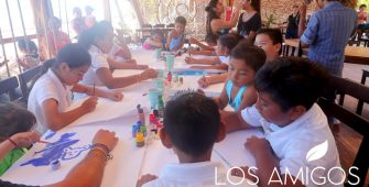 Kids celebrating at Los Amigos Beach